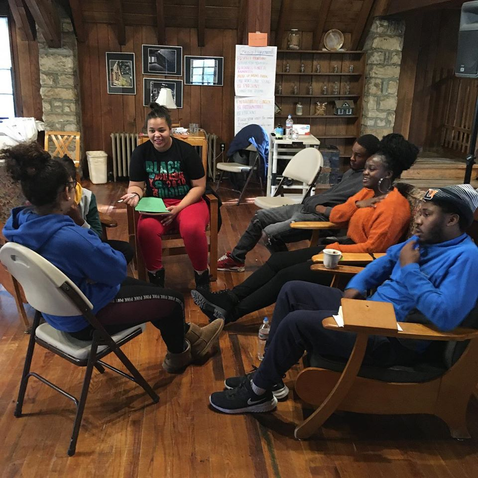 A small group of young Black appalachians at the gathering discusses change making in Appalachia for african americans.