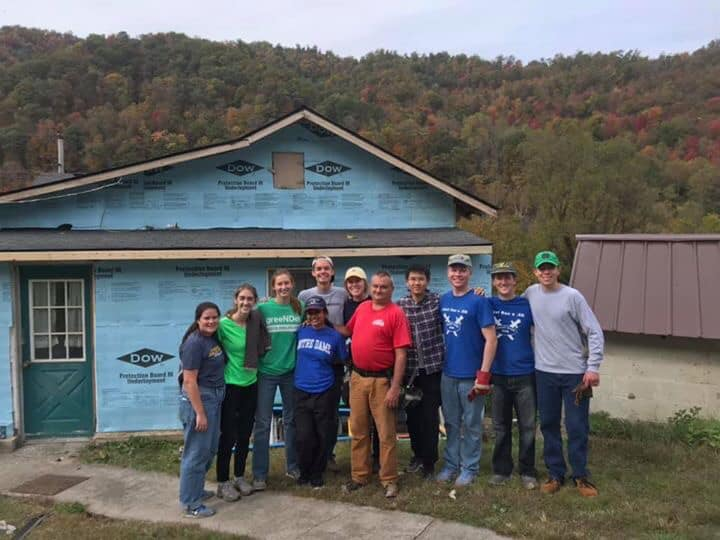 Volunteers stand in front of a house they are building with COAP, Inc., a housing non-profit in Southeastern Kentucky.