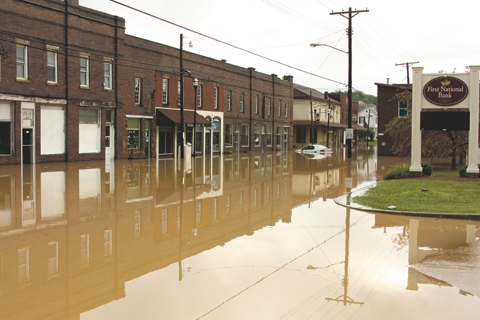 FLooded streets in downtown olive hill, kentucky in 2010. The carter county community has been working on involving youth to rebuild