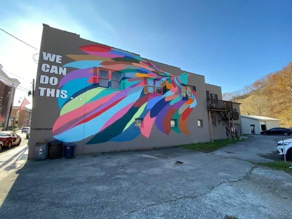 A peacock is painted on a wall in downtown Hazard as a part of a new mural project promoting togetherness.