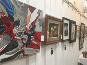 Pictures hang on a wall at grayson art gallery in eastern kentucky.