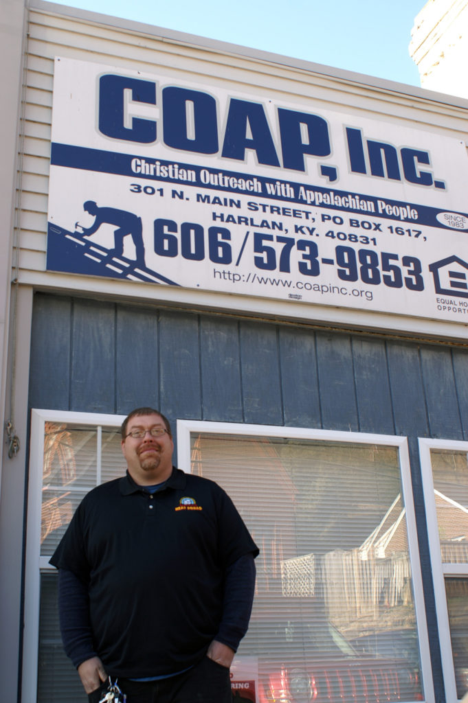 Randall Howard stands in front of COAP, Inc. He manages the Appalachian Heat Squad program that does energy efficiency in coal country.