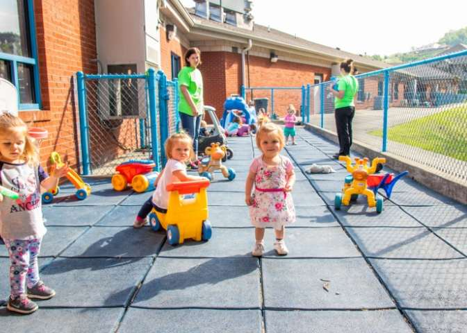 Children play outside of New Beginnings in Hazard, Kentucky. The facility helps counter a lack of Eastern Kentucky childcare access
