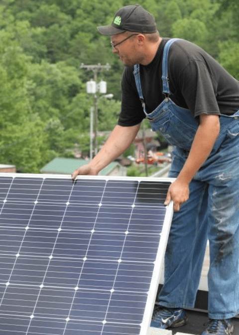 Fuzz Johnson installs solar on HOMES rooftop in Letcher County in Eastern Kentucky. Many nonprofits go solar with MACED's upport
