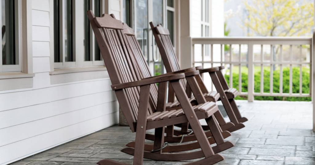 Rocking chairs sit on a front porch at an airbnb in eastern kentucky.