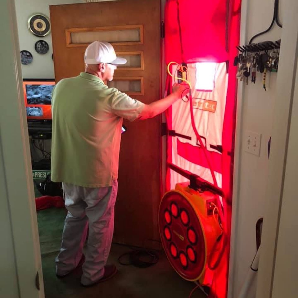 Scott conducts a blower door test to look for energy leakage in a home in Eastern Kentucky. This will help the home be more energy efficient