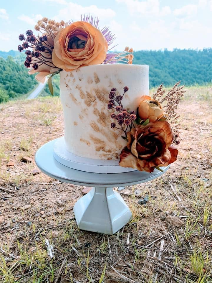 A wedding cake with flowers decorating it in floyd county, kentucky.
