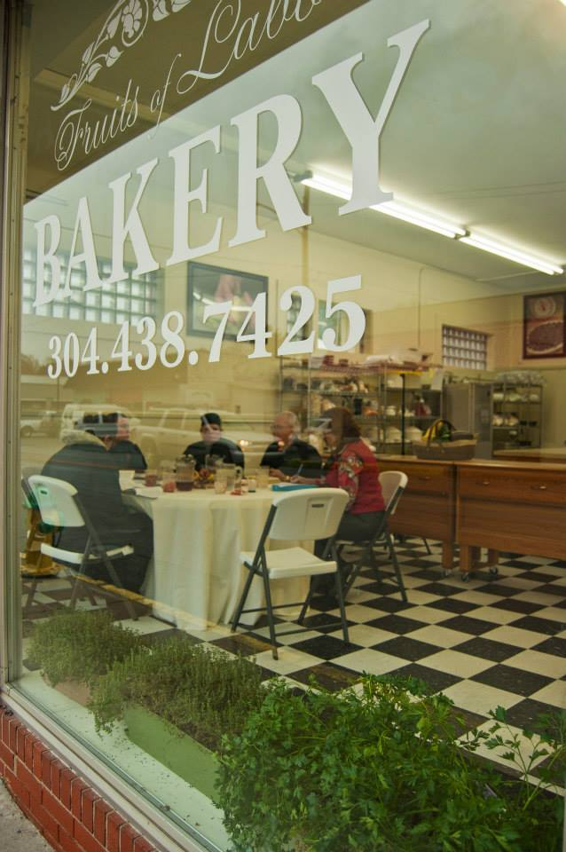Part of the students training is to also learn food presentation and serving skills. The cafe window in Rainelle, West Virginia, is labeled Fruits of Labor.