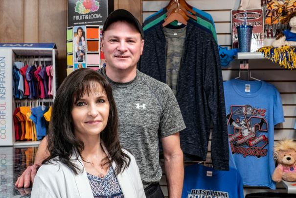 Gina Rose and Geoff Crisp of The Shirt Gallery stand inside their business in Martin, Kentucky, in Floyd County.