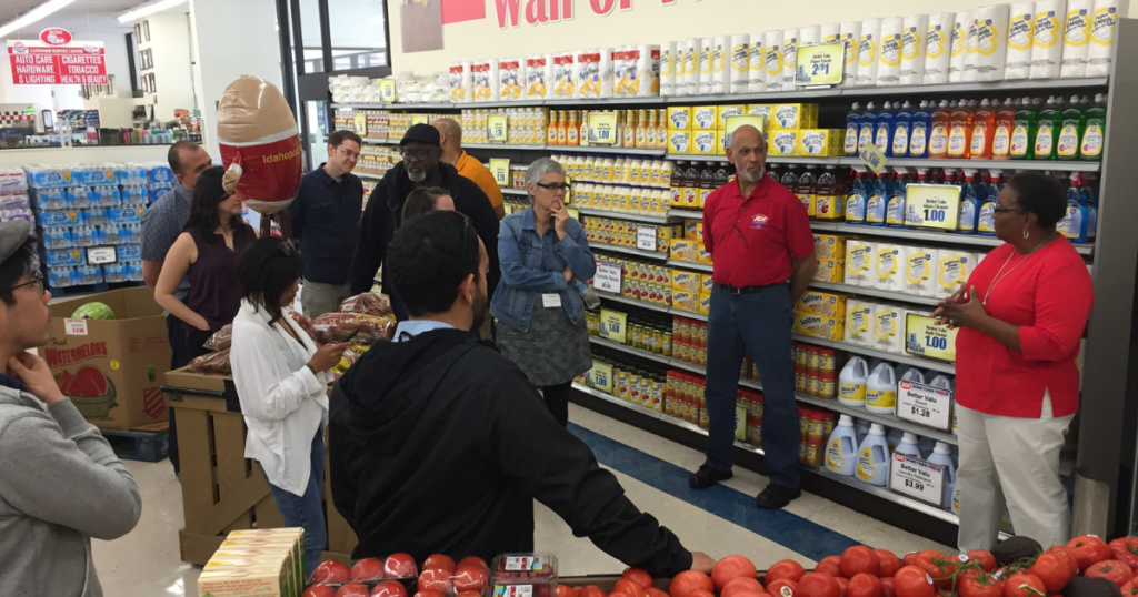 Gwen Christon with a group of people touring her store, Isom IGA, in Letcher County, Kentucky. The store leads in rural energy savings
