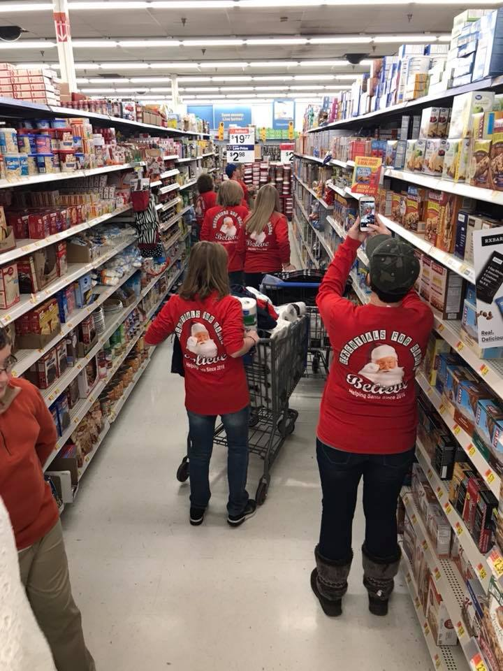 Volunteers with Kent Rose Foundation get supplies for kids and young people in eastern kentucky.