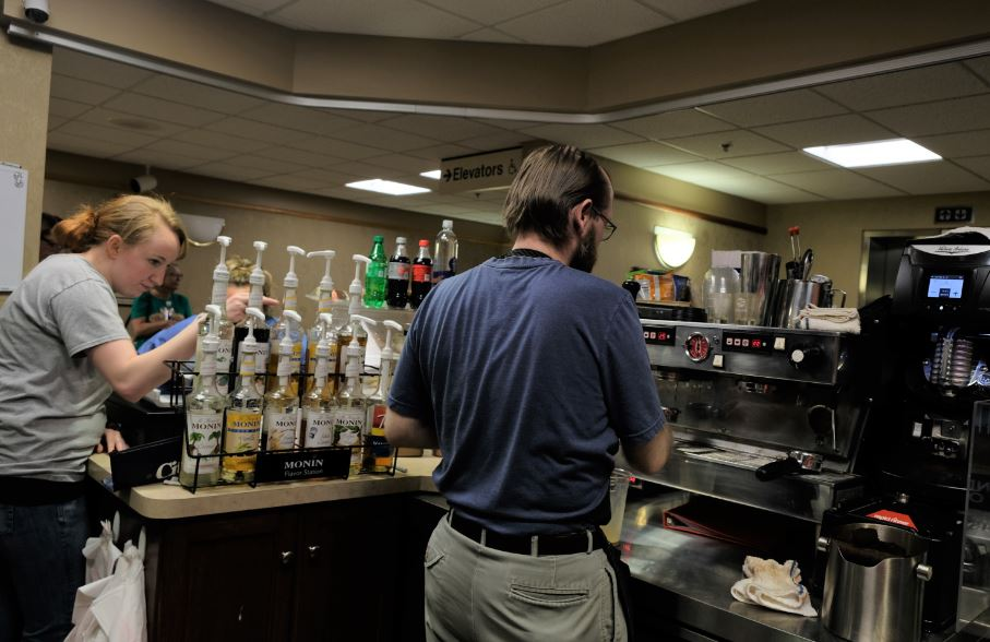Two employees work behind the coffee counter at Pour House Coffee in King's Daughter Medical Center and Hospital in Ashland, KEntucky.