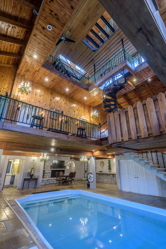A swimming pool and multiple levels of the house inside longview estate in garrard county.