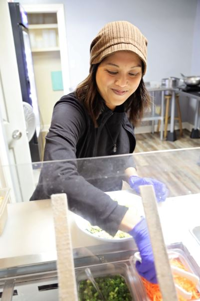 Mae Suramek serves noodles at Noodle Nirvana her business in Berea Kentucky. The woman owned restaurant is a social enterprise