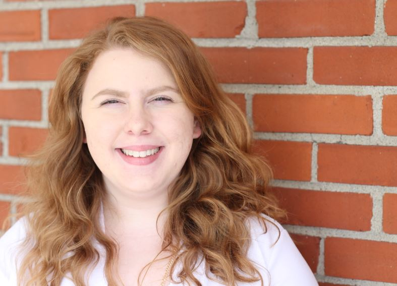 Megan Stepps smiles for her MACED New Energy internship portrait. She helped market the Appalachia Heat Squad in Eastern Kentucky.