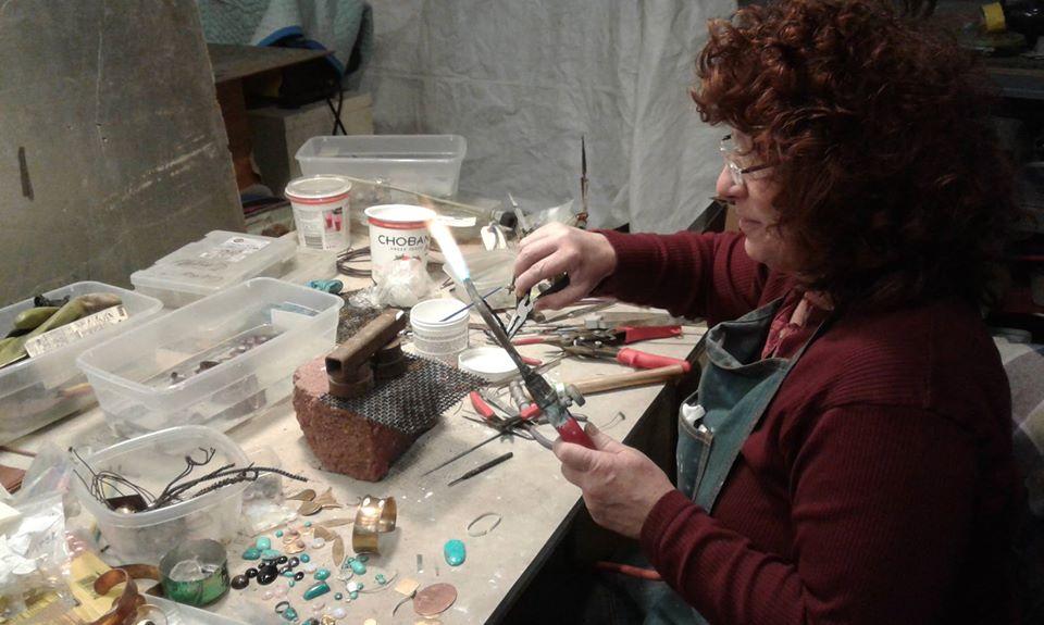 Nora Swanson makes jewelry in her studio in Berea, Kentucky. She created the social enterprise Kinetic Soul Food for Appalachian women