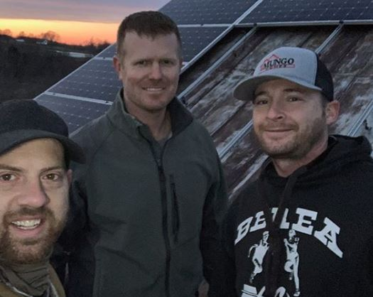 Bryce Baumann and two friends after they completed the solar panel installation on the barn of Lazy Eight Stock Farm in Paint Lick, KY.