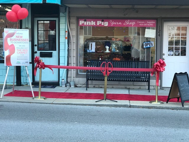 A ribbon cutting in front of Pink Pig Yarn Shop in downtown pikeville, kentucky. The shop opened in October 2020.
