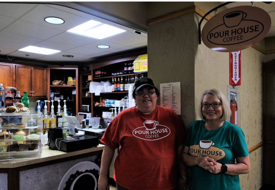 Two owners stand in front of Pour House Coffee. Kim Klien and Tiffanie Ricework own the shops partly financed by MACED business loan