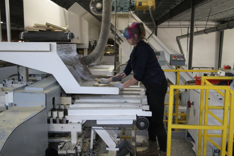 An employee at Powell Valley Millwork works some of the machinery. They are the second largest employer in Powell County