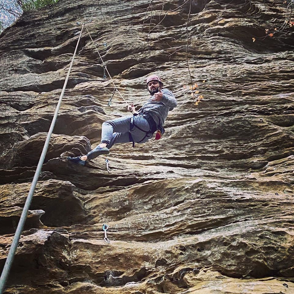 Man rappels with Southeast Mountain Guides, in the Red River Gorge, Kentucky. They are supported by a MACED business financing