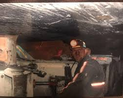 Scott Shoupe is shown underground as a coal miner. Now he works in energy efficiency and solar in Eastern Kentucky