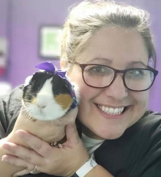 Pet groomer holds a guinea pig at her woman owned business, Waggin Tails, in letcher county, kentucky.
