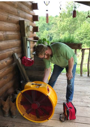 Zac Ebersole, former MACED New Energy Intern, conducts an energy efficiency blower door test during the Silver Run audit in Catlettsburg, Kentucky.